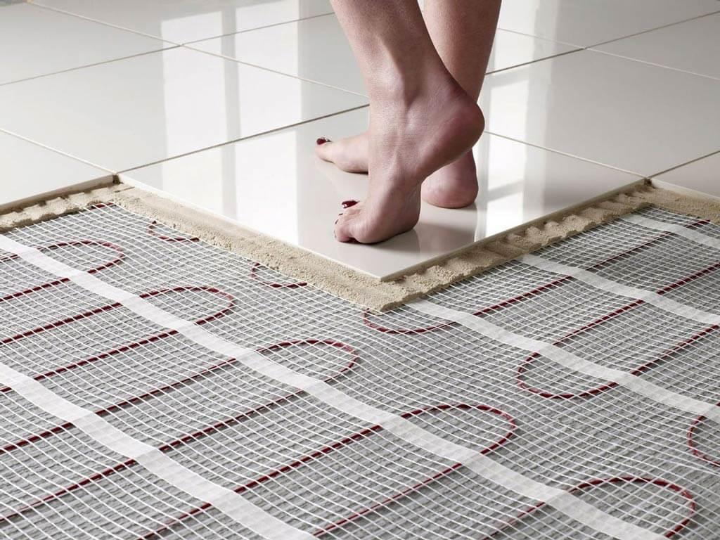 Какой теплый пол лучше выбрать под плитку или ламинат?